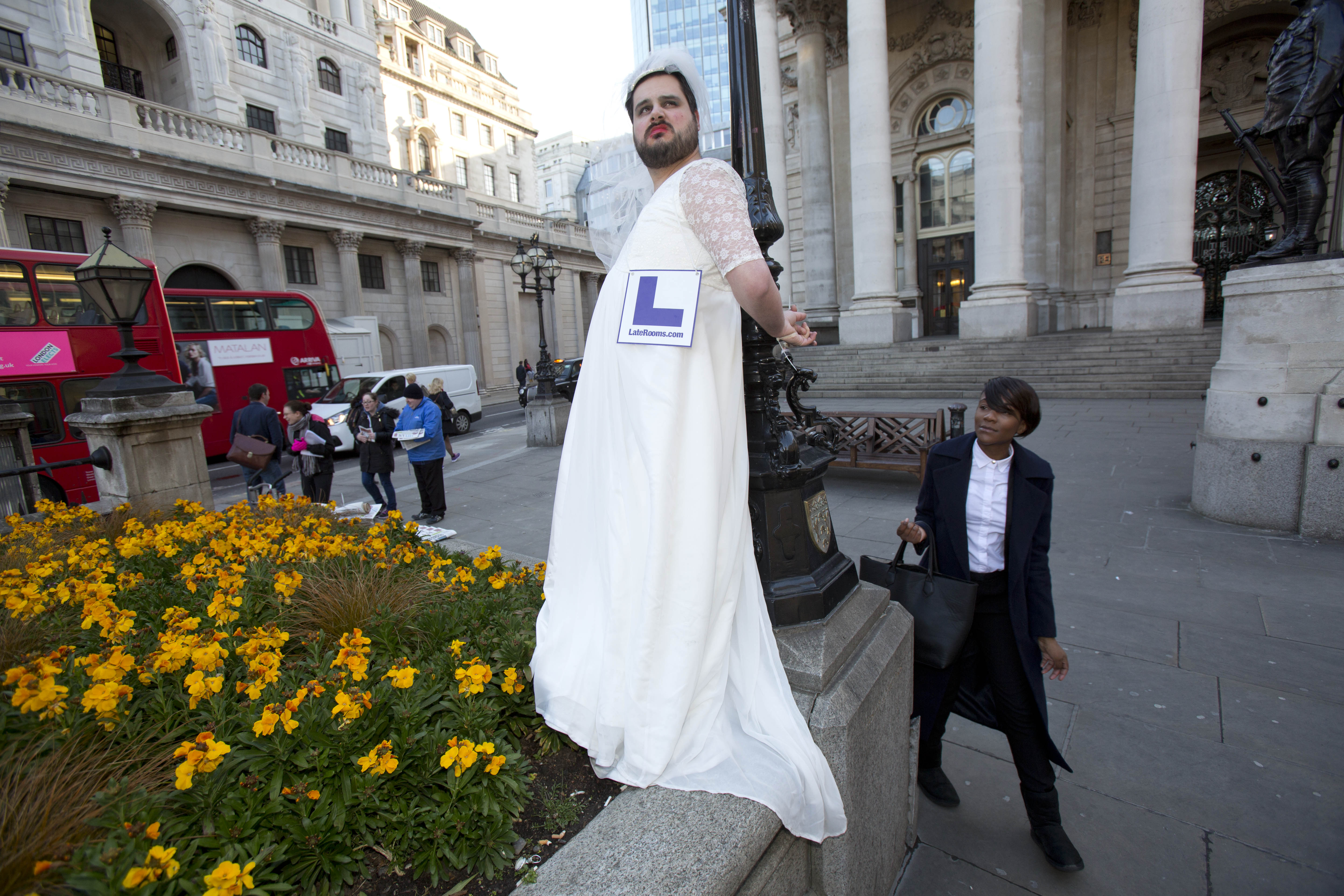 DonÕt Tell The Bride!Ê London city workers got an eyeful this morning as a number of ÔStagsÕ were spotted across the capital, including this chap who was photographed dressed in a wedding dress and tethered to a bench in the heart of The City. The scenes were created as living advertisements by LateRooms.com to celebrate the start of peak wedding season, as research reveals that 60% of stags will be sent off into married life with a holiday blow out that will cost attendees an average of £346 a head. ÊPhoto credit should read: Tim Anderson